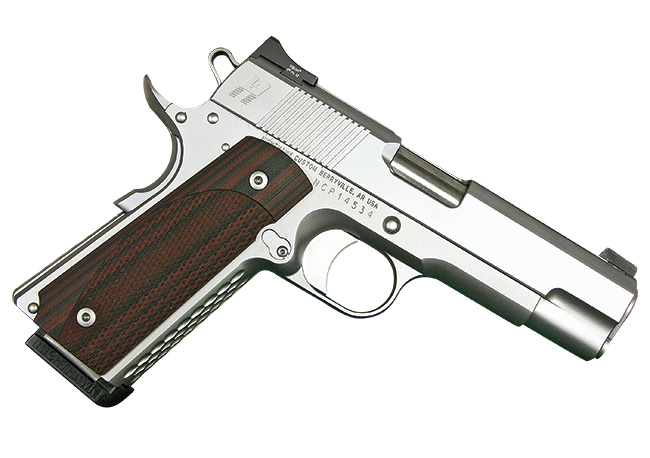 //www.shootingtimes.com/files/1911-colt-commander-still-going-strong/nighthawk_heine_signature_1911_commander.jpg
