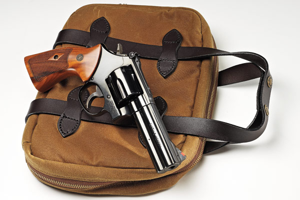 Like a phoenix out of the ashes, Smith & Wesson's classic, double-action, blued-steel,