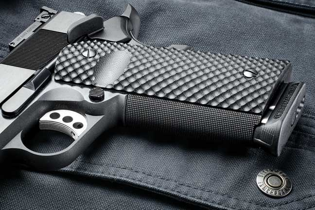 The frontstrap is checkered 20 lines per inch; the G10 grips are textured; and the flat mainspring housing is serrated. Together they provide a secure grip without biting into the shooter's hands.