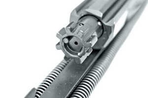 The MCX has several noteworthy features not commonly found on your average AR-15, including ambidextrous magazine release and fire control selector and levers on both sides of the charging handle. Because it's a piston-driven AR, the MCX runs clean. Shown here is the bolt after 100 rounds had been fired.