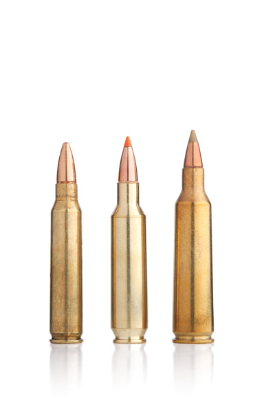 The .22 Nosler (center) not only outclasses the standard 5.56/.223 (left), but it also nips at the heels of the .22-250 Remington (right).