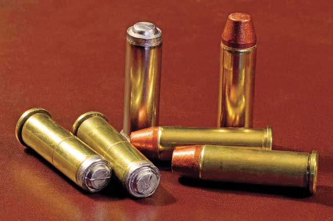 Two light practice loads—one with 148-grain lead wadcutters at a muzzle velocity of about 500 fps, the other with copper-coated 125-grain semi-wadcutters at around 650 fps—provided a graduated progression in recoil up to the tactical ammunition.