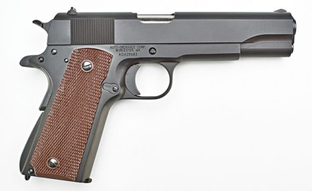 The Auto-Ordnance 1911BKO resembles the military Model 1911A1, and it uses a 5.0-inch barrel, a standard recoil spring guide assembly, fixed sights, and brown plastic grip panels, although it has several differences from the original military 1911A1.