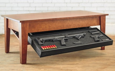 Tactical Walls Concealment Coffee Table houses home-defense guns, including AR-15s, shotguns, and handguns. An RFID-activated shelf drops down, providing quick access to the home owner.