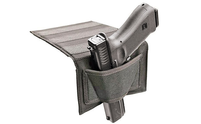 The nonslip flap of this bedside holster from Blackhawk fits between the mattress and the box springs. The ambidextrous design allows it to be used on either side of the bed.