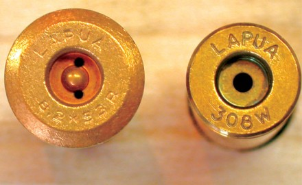 The rather complex Berdan priming system (left) used a simple cup containing an explosive mix that was seated in a cartridge case having a complementing pocket configuration. The bottom of the pocket was formed with a round teat in the center and two small flash holes. The Boxer primer (right) contains the explosive mix and an integral metal anvil, and the case's primer pocket is a much simpler cylindrical cavity with a single, larger-diameter flash hole in the center.