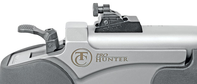 The rear sight is a fully adjustable peep type. It must be removed in order to install scope mounts.