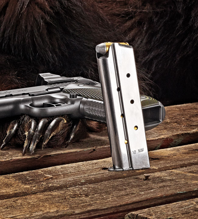 The pistol's magazine holds eight rounds of hard-hitting 10mm Auto ammo, and it has a flat follower and side witness holes. Its base is drilled and tapped for installing a bumper pad.