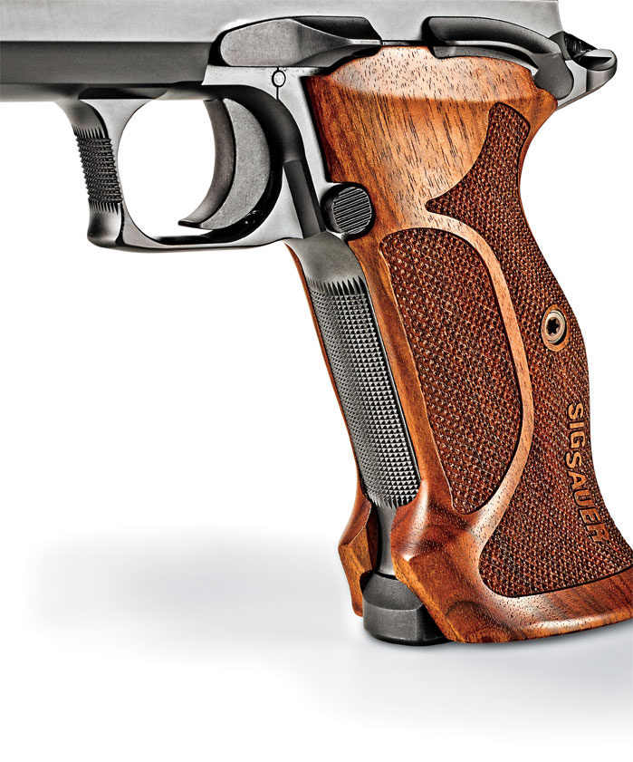 The pistol's contoured and checkered target-style grips are comfortable and good looking. They wrap around the frame, leaving the checkered frontstrap open. The single-action P210 design has always been known for its excellent two-stage trigger pull. The sample pistol's pull was smooth and crisp and averaged 3 pounds, 9 ounces.