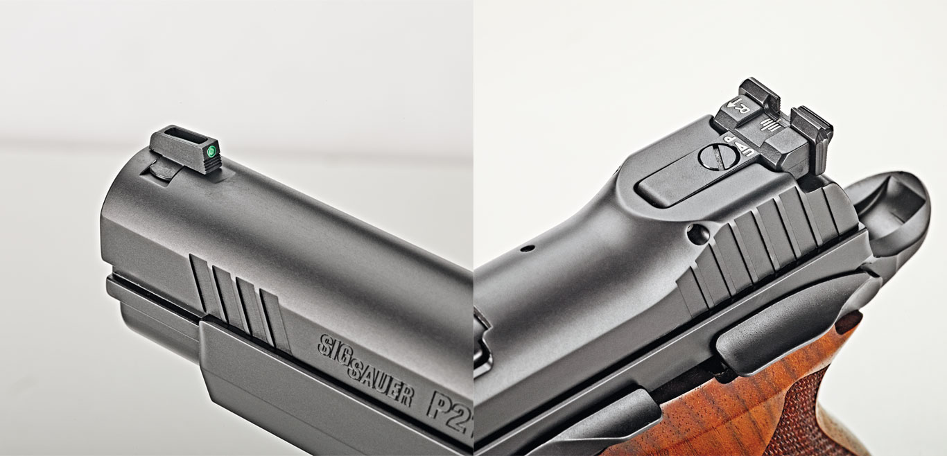 The sights are a fiber-optic front post and a fully adjustable black rear. The rear sight is recessed into a raised portion of the slide.