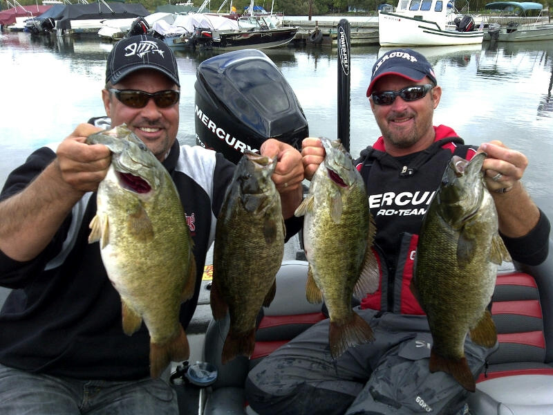 Mark Zona, left, and Jeff Kriet with four handsome smallmouth bass that were caught on the Dreamshot