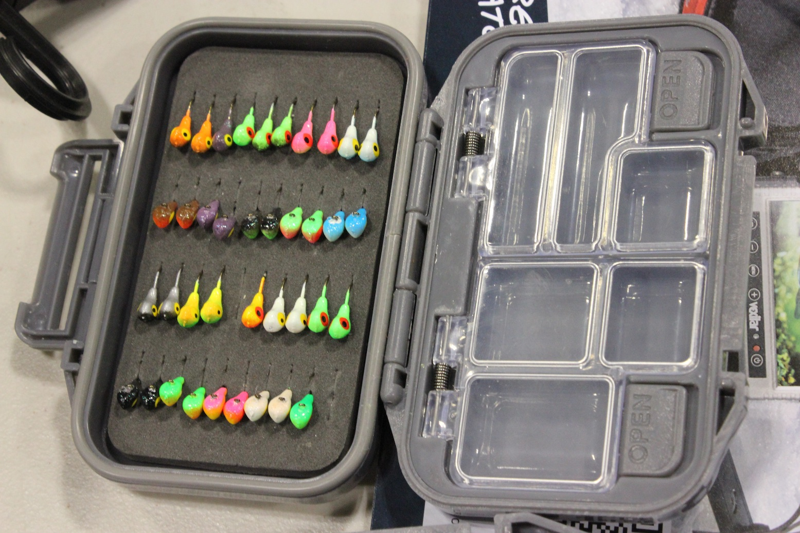 This is Clam's new Ice Armor Jig Box. Spotted it on the desk Dave Genz was using at the Ice