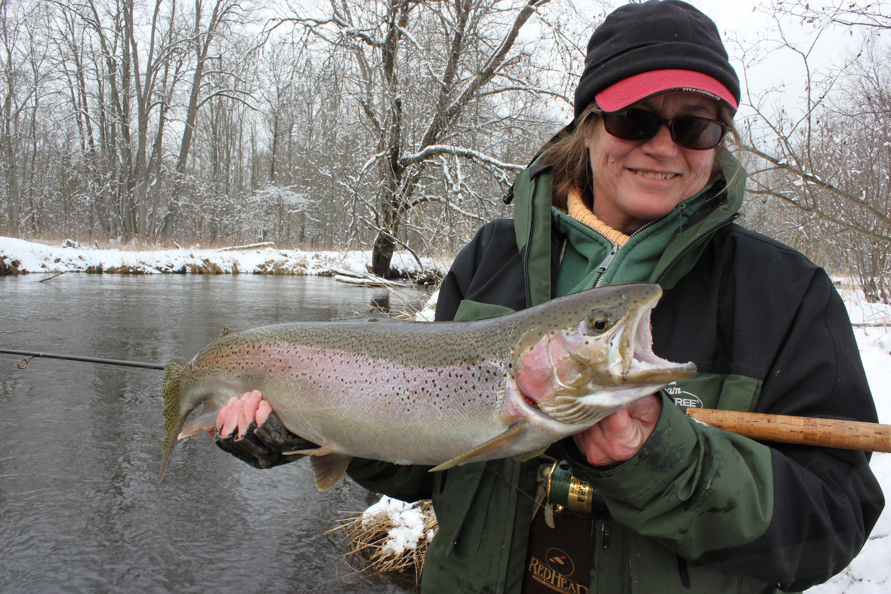 Here's Mary Savage, spiking Rick Hammer's favorite drift on Michigan's Pere Marquette River. I