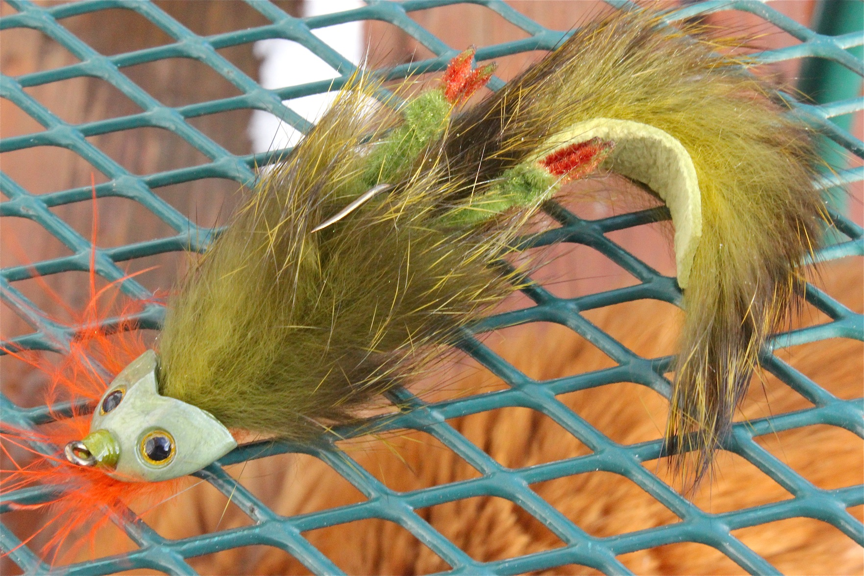 Paul Jensen, owner of Jensen Jigs,  has been tying hair jigs for decades. Sometimes he just sits