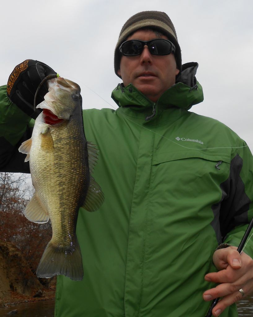 Mike Myers of Lawrence, Kansas, with the first largemouth bass of the outing.