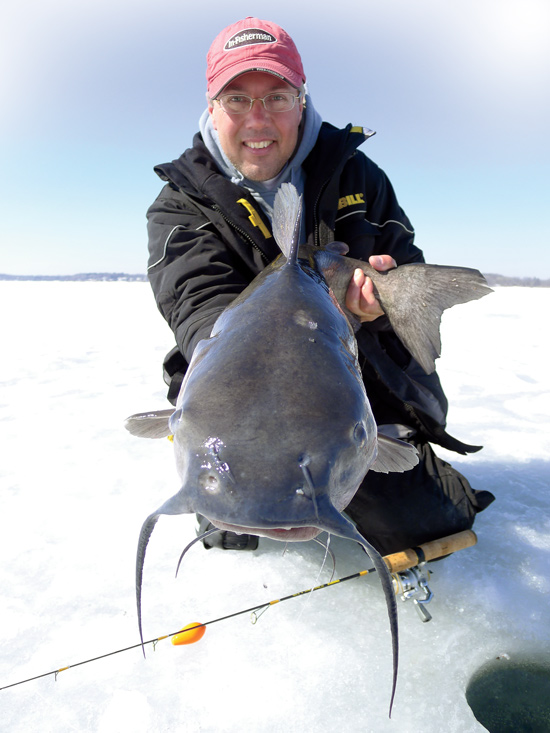 ice fishing catfish in fisherman