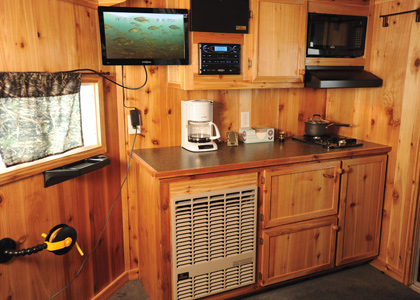 Tricked out ice fishing houses in fisherman for Ice fishing shanty for sale