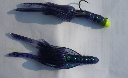 Two Junebug Bailey Magnet Magnums. The top one is affixed to a chartreuse 1/16-ounce