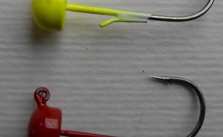 Z-Man Fishing Products' 1/15-ounce chartreuse and red Finesse ShroomZ jigs.  Before April