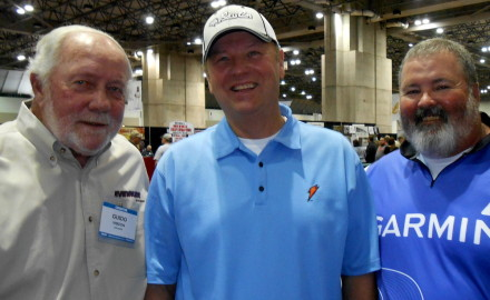 Guido, left, and Dion Hibdon with Dennis Davey of Osawatomie, Kansas, who was one of the many fans