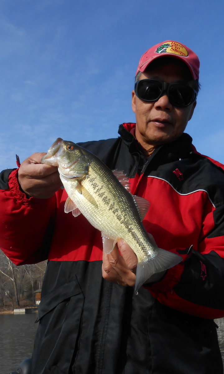 Pok-Chi Lau with the first largemouth bass of the outing.