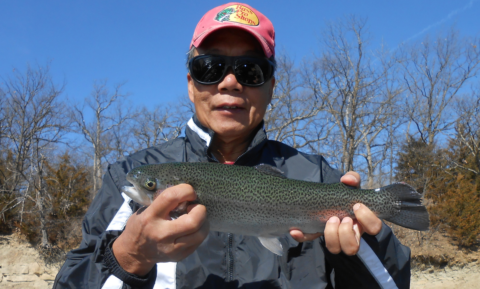Pok-Chi Lau holds the first trout of the day.