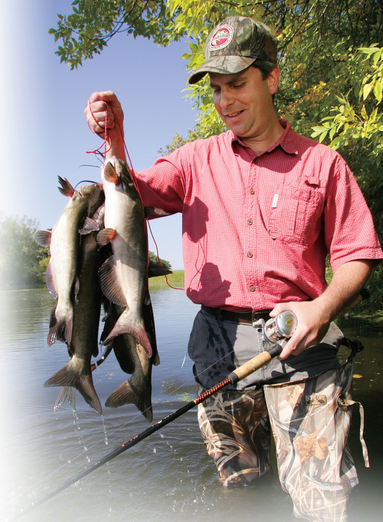 Zakk Royce Right Poses With His Record Blue Catfish Before Letting It Go Photo Courtesy Of