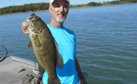 Bob Gum of Kansas City, Kansas, with a northeastern Kansas smallmouth bass that he caught in
