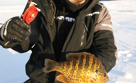 Some anglers equate ice fishing to a game of checkers. Tony Boshold views the experience as a