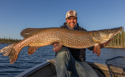 Gord Pyzer has learned that giant pike often prowl isolated vegetation near deep water in early