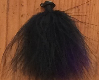 One of Jeff Gustafson's black-and-purple marabou jigs.  The marabou jig used to play a
