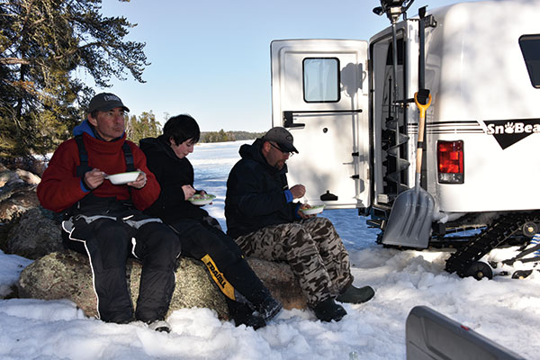 Eating Shore Lunch While Lake Trout fishing on the Canadian Shield