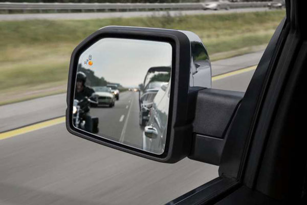 Available as on option on the F-150, Ford's Blind Spot Information System (BLIS) uses sensors to indicate (via an LED light in the side mirror) when there's a vehicle in the driver's blind spot.