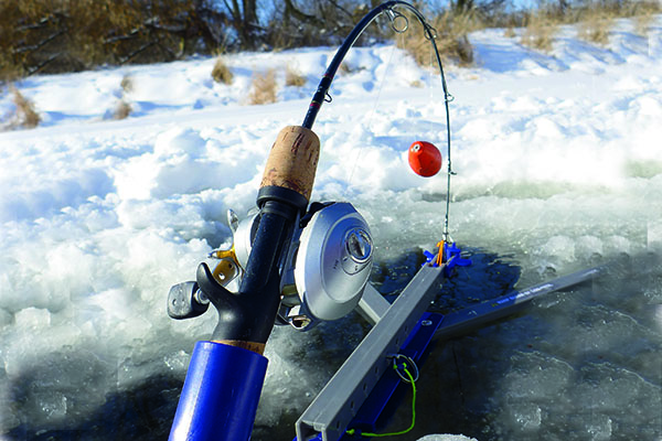 4 automatic ice fishing tools you 39 ve gotta try in fisherman for Jaw jacker ice fishing