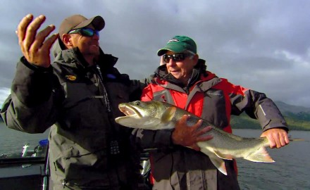 Doug Stange samples ice-out lake trout in Rocky Mountain high country.