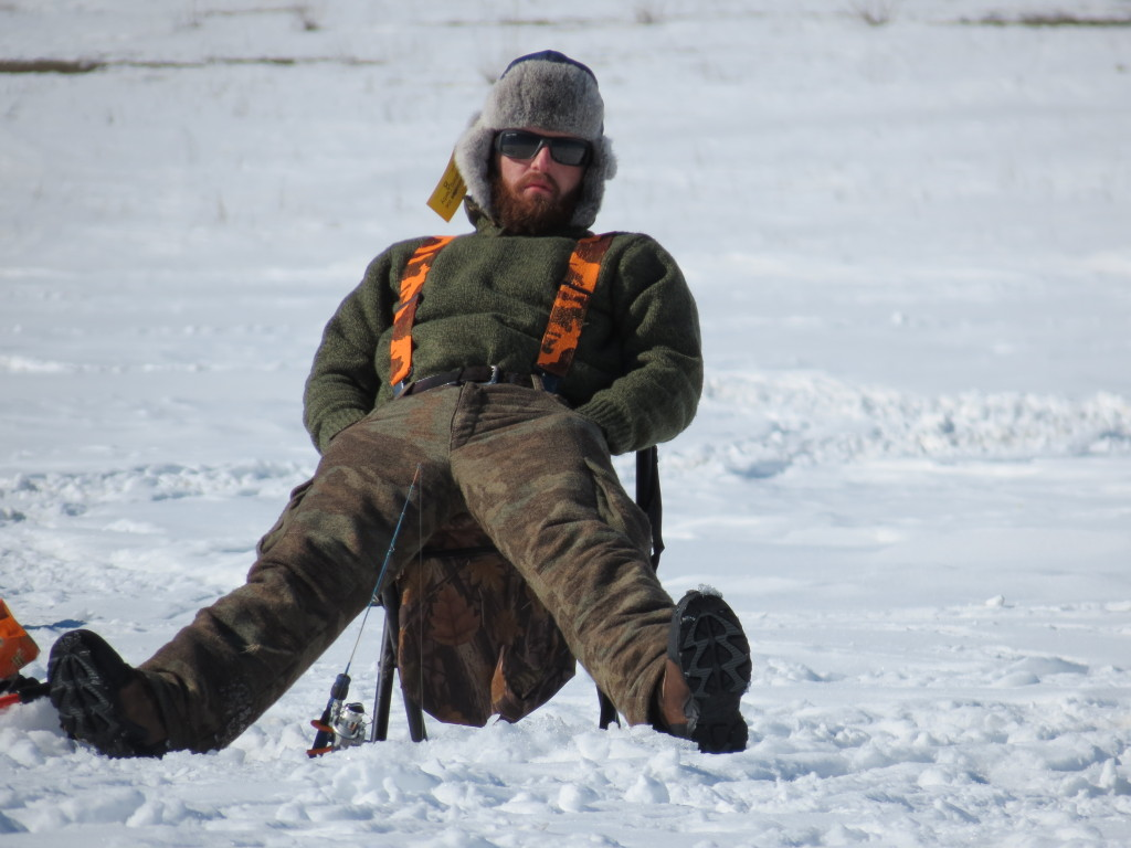 Shawn Gilchrist of Cody, Wyoming waits for his fish to come his way at the Meeteetsee Ice Fishing derby in Meeteetsee, Wyoming.