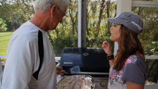 Jana and her Dad Paul cook up the tilapia and share a few laughs
