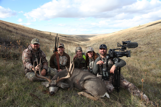 Heather and her son Wiley proudly pose with her magnificent Oregon muley alongside the Scott Coe and the Skull Bound crew.