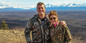 Sarah Palin and Sgt. Meyer pause to take in the breathtaking views before descending back down the trail.