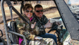Sgt. Dakota Meyer and Sarah Palin have a blast as they approach the summit.