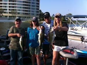 The kids, smiles, and their bass at the end of the day