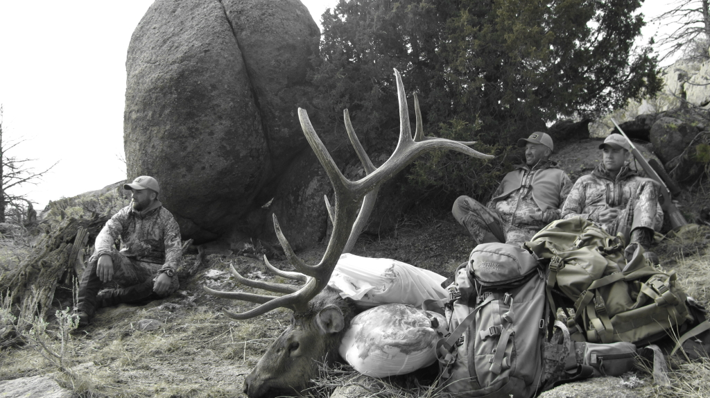 Taking a break from the grueling task of packing out the elk.