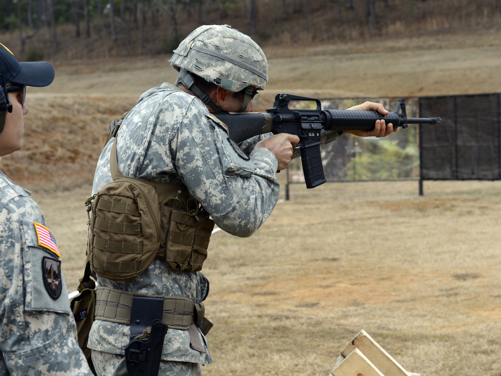 FORT BENNING, Ga. – Army Reservist Master Sgt. Russell Moore (center) fires on a target during the Combined Arms match Feb. 1 at the 2014 U.S. Army Small Arms Championship. Moore held off stiff competition from Soldiers from Active Duty, Army Reserve and National Guard to claim his fifth title at the All-Army. (Photo by Michael Molinaro, USAMU)