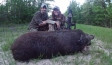 After a slight gun malfunction, Jana borrows Travis's AR and scores the first feral hog for the smoker.