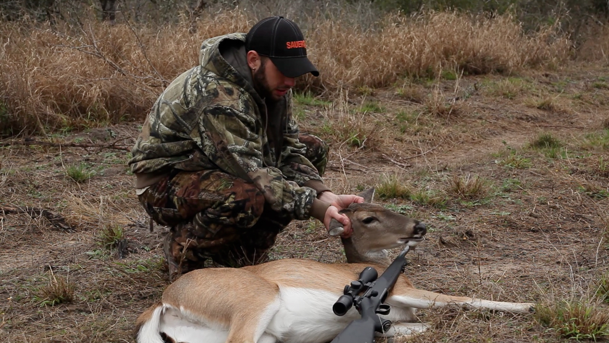 John after taking a doe with his Sauer 101