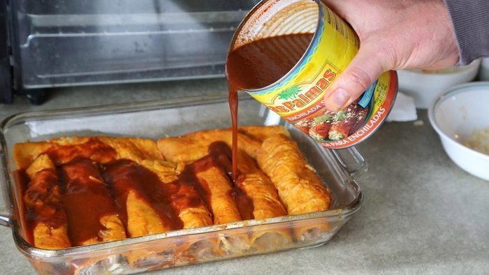 Pour enchilada sauce over the filled tortillas. (Jenny Nguyen photo)
