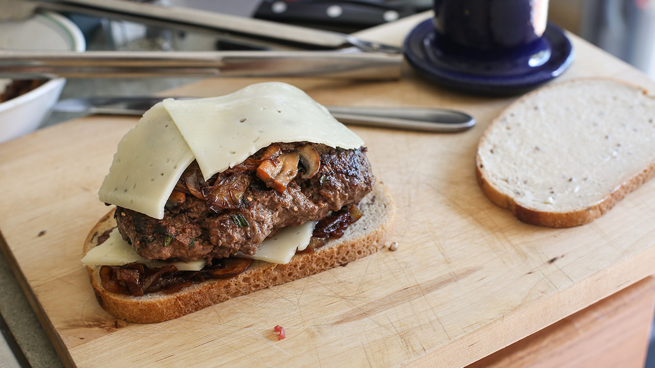 Browned venison patty with caramelized onion, mushrooms and Swiss cheese on rye bread. (Jenny Nguyen photo)