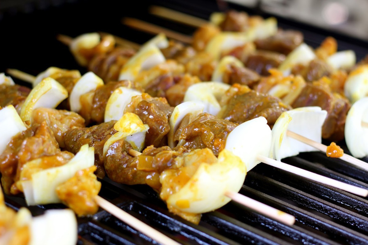 Apricot and yellow curry venison skewers on grill. (Jenny Nguyen photo)