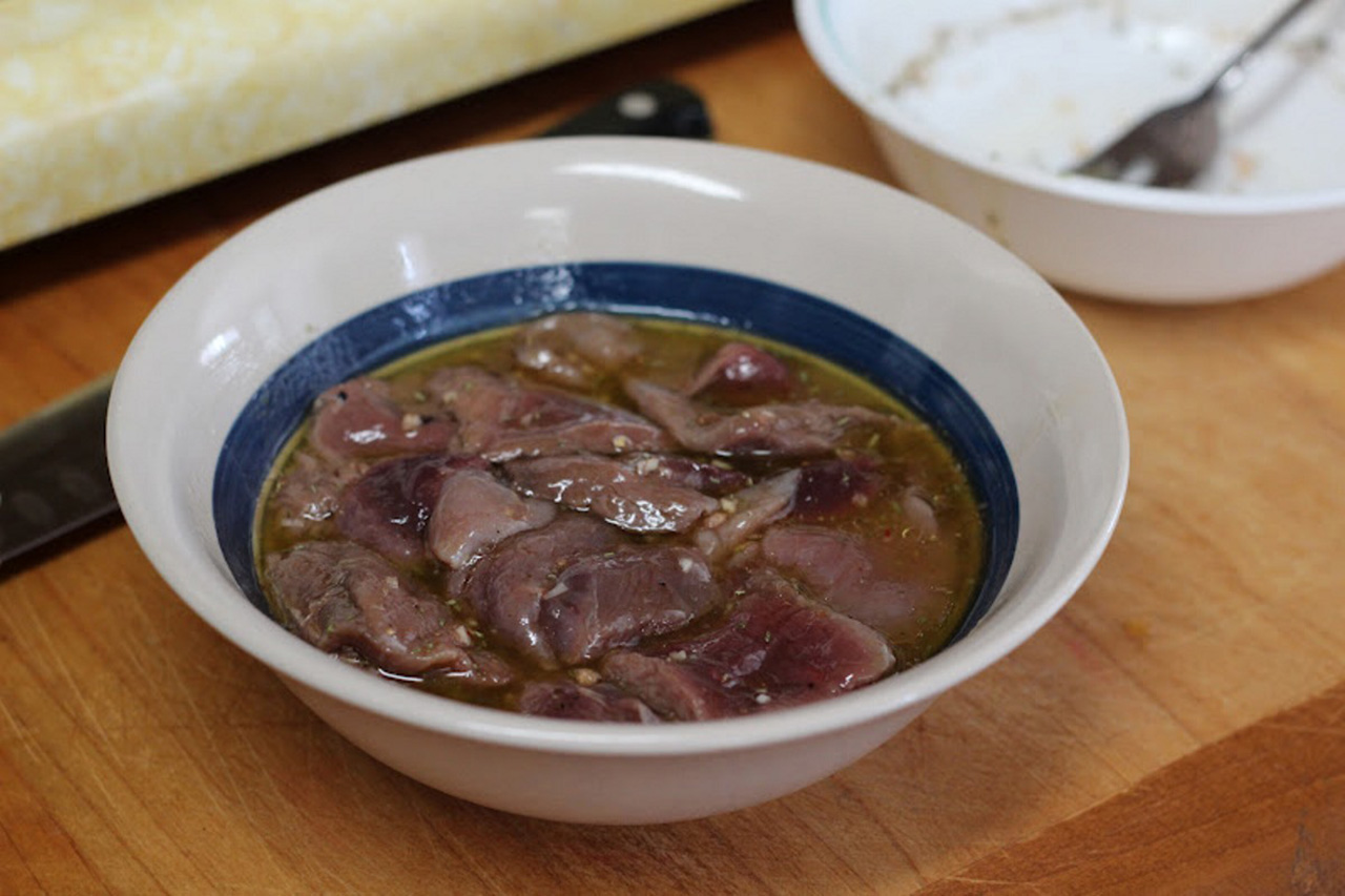 Venison marinating in olive oil, red wine vinegar and herbs. (Jenny Nguyen photo)