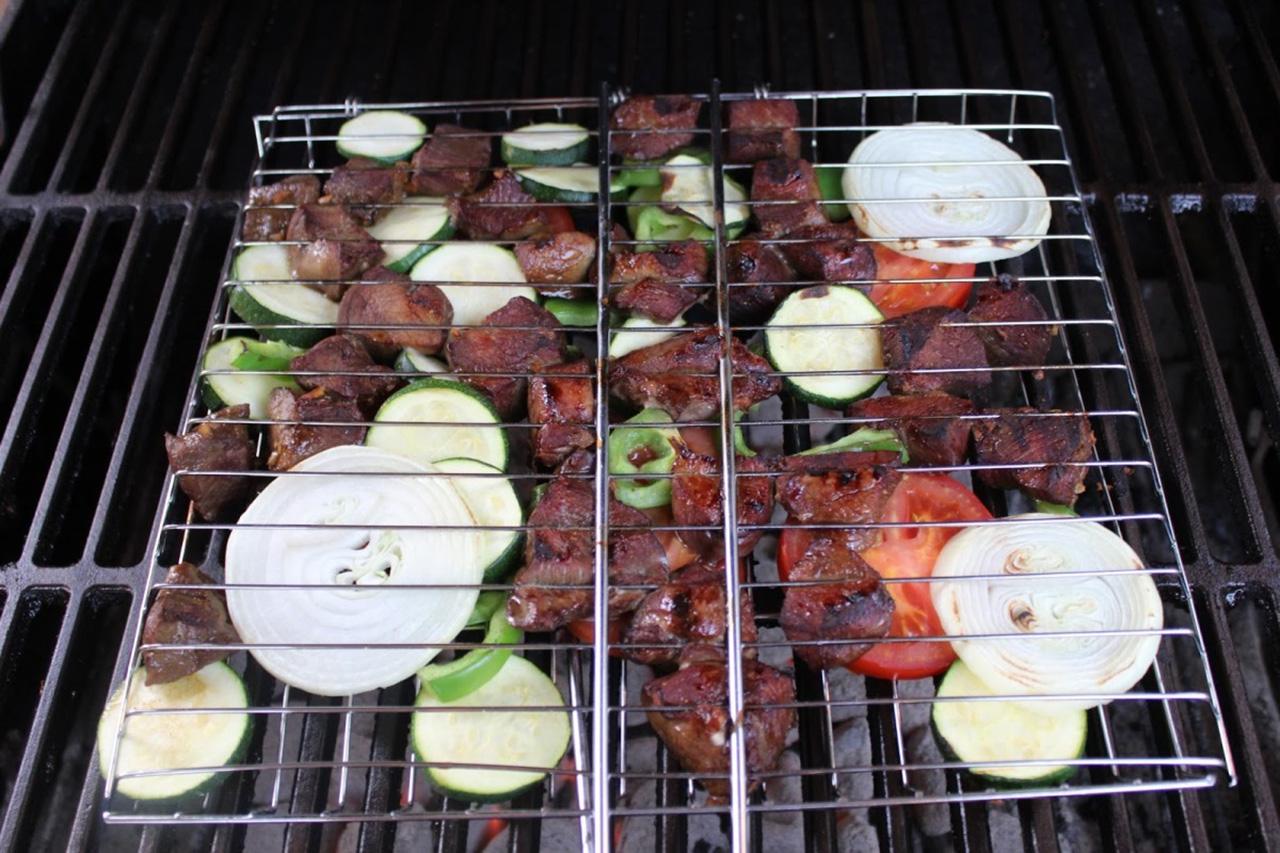 Wine and soy sauce venison with vegetables on grill. (Jenny Nguyen photo)
